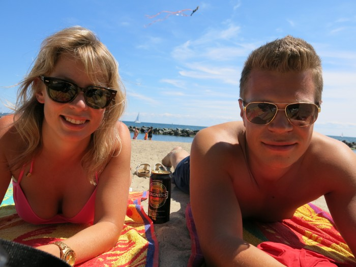 Cider and laying on the beach towels on Ward Island in Toronto