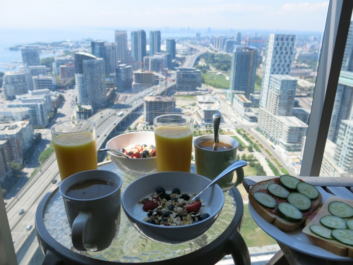 Breakfast at Hights, on a condo balcony with a Toronto skyscrapers view