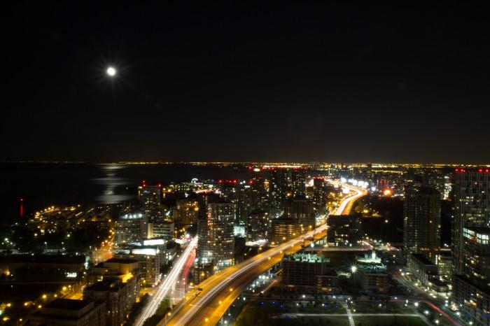 Toronto city under the moon at night