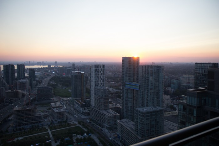 Toronto at dawn, sun is rising over the skyscrapers