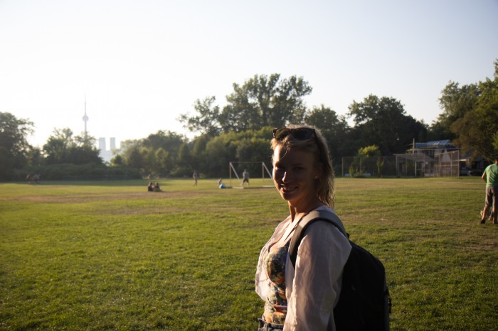 Summer girl in a park in Toronto Ward Island and the CN Tower