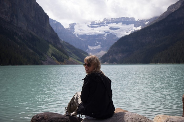 Travel blogger by the Lake Louise in the Rocky Mountains in Canada