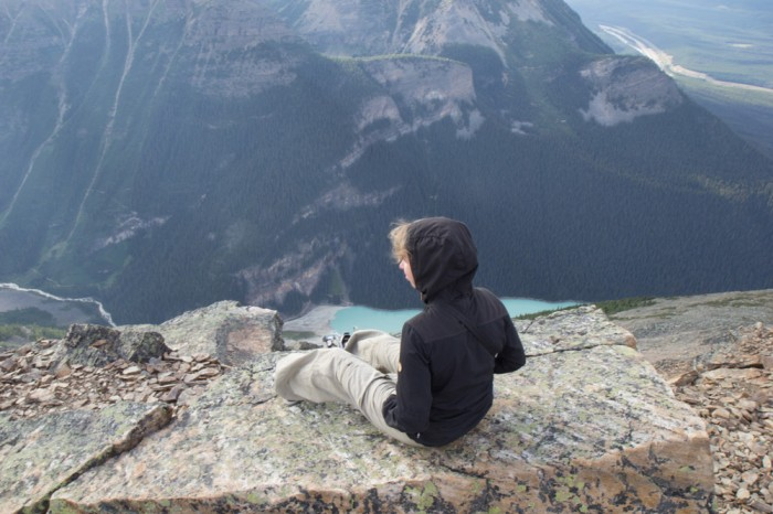 Travel blogger on the top of Fairview Mountain in the Rocky Mountains in Canada