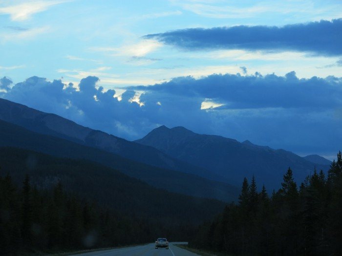 Blue clouds and the sky on the Icefield Parkway in the Rocky Mountains, road trip and the blue moment
