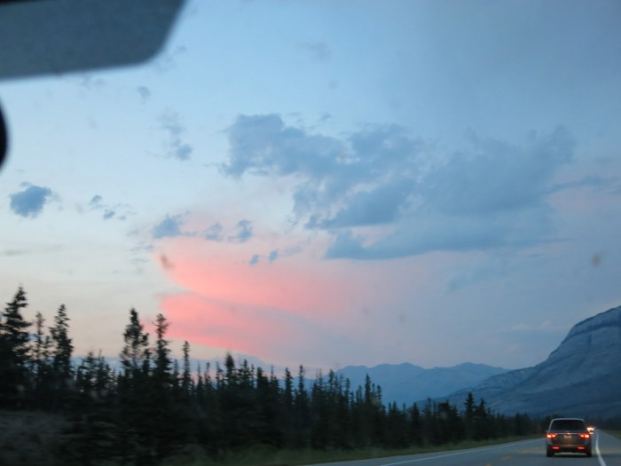 A road trip under the pInk clouds and the baby blue sky in the Rocky Mountains