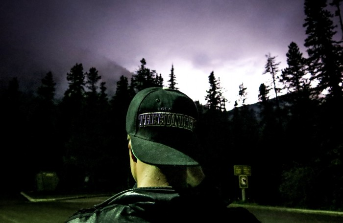 Thunderstorm in Jasper, a lila sky and a guy in the Hundreds cap in the Rocky Mountains