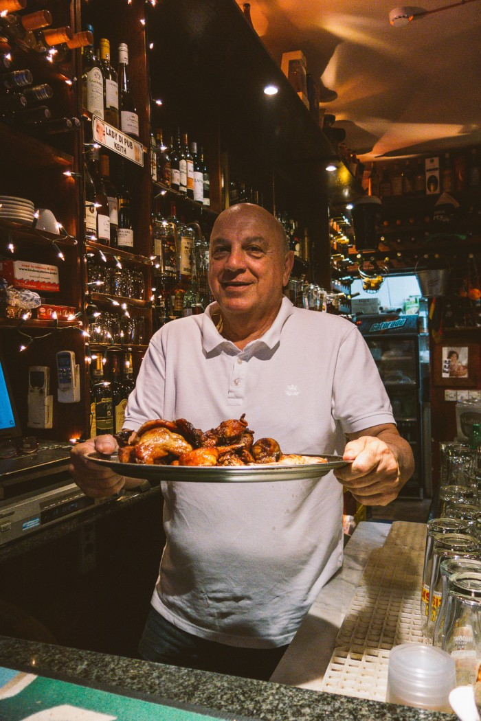 Lady Di's owner Frank serves some Fenek - rabbit